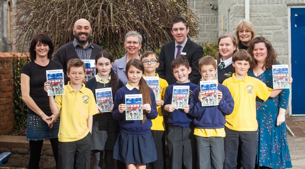 "GWR-From left, Melissa Muldoon, Headteacher Mr Iannis Ireland, Celia Minoughan from the Devon and Cornwall Railway Trust, Station Manager Nicholas Reid and Author Susan Quayle, with pupils at Starcross Primary School in Devon, after the launch a new book called, ""The Seaside Train"". 23/03/2016"