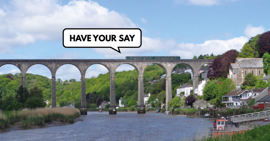 "Train on the Calstock viaduct with speech bubble: ""Have your say"""