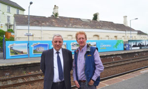 richard-burningham-and-richard-bickford-with-station-hoardings