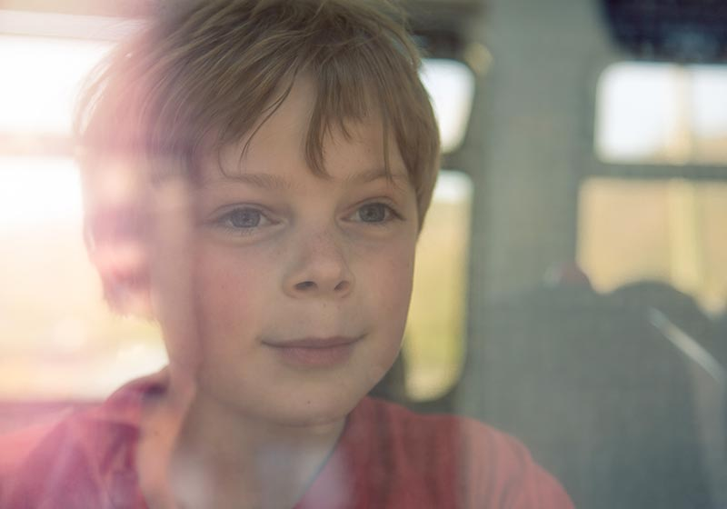child-looking-out-of-train-window