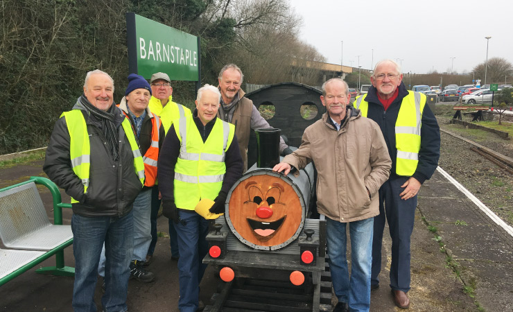 Mens Sheds Torrington group pose with the train model