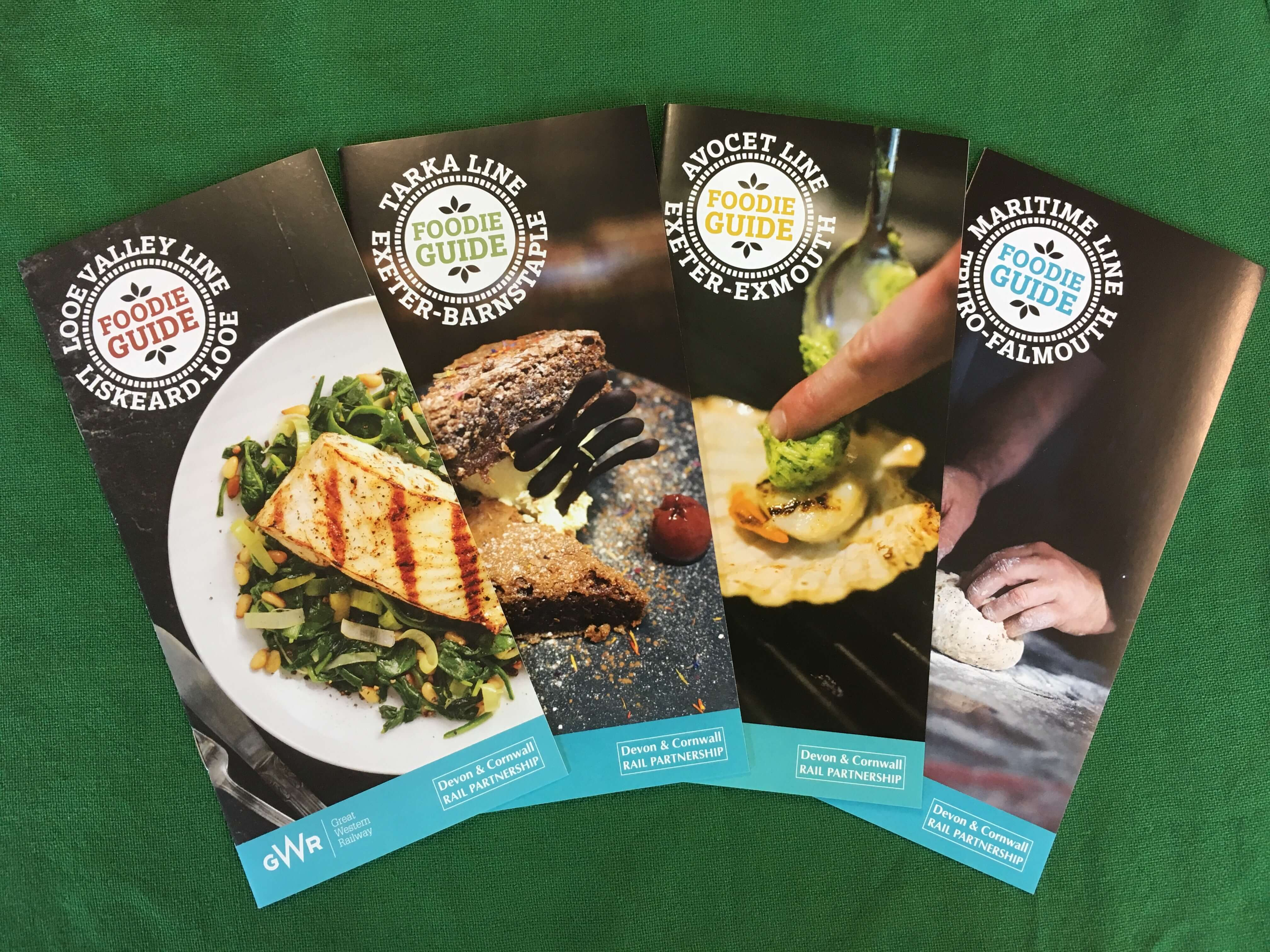 Front covers of four Foodie Guides