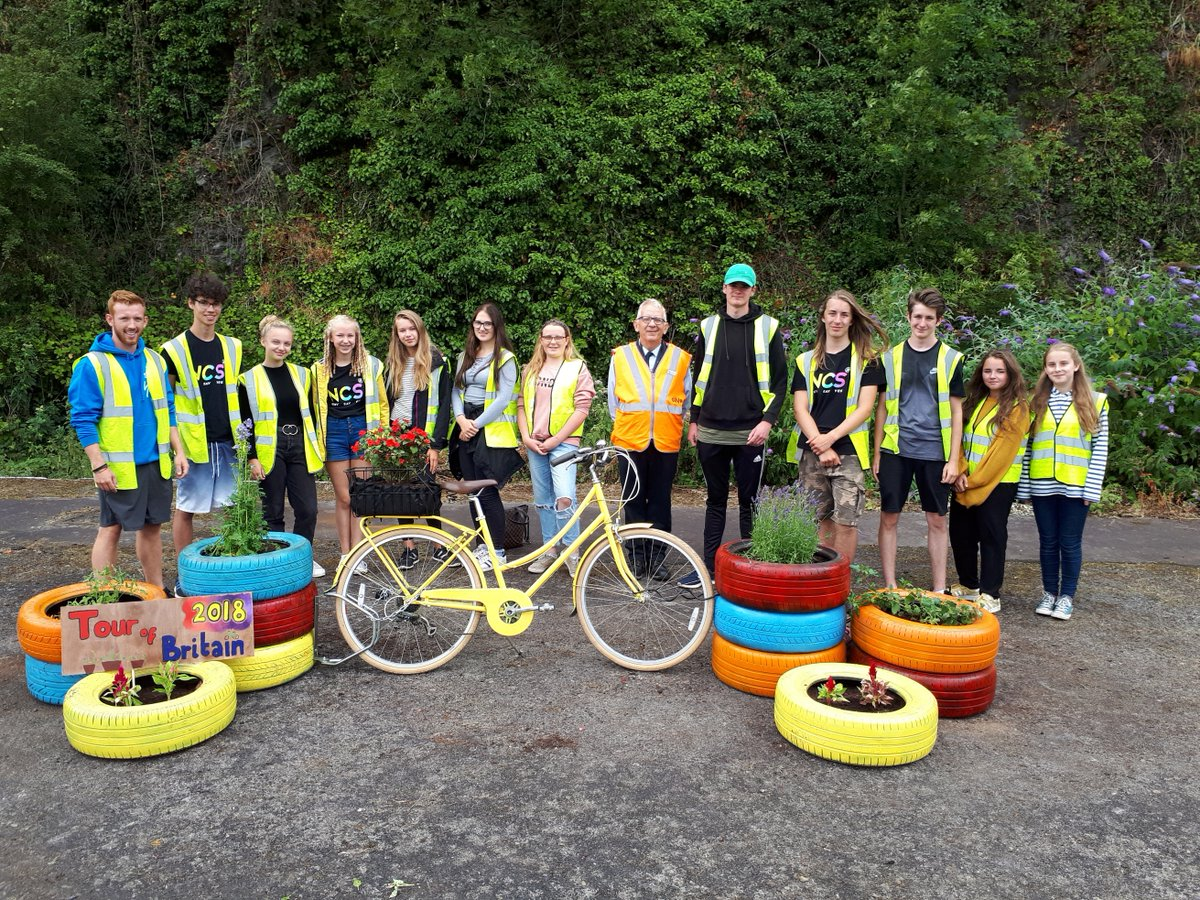 Petroc students with the upcycled planters and donated bicycle